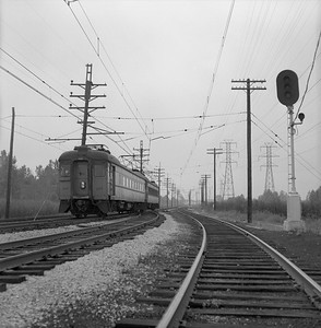 2018.15.N64.2952B--ed wilkommen 120 neg--CSS&SB--electric interurban 107 on passenger train--location unknown--1961 0904