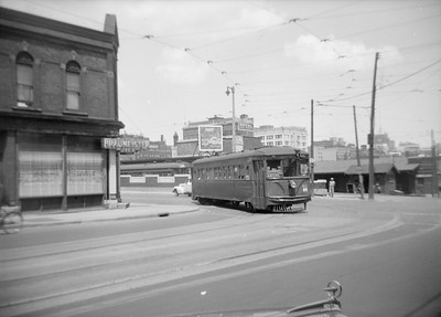 2018.15.N91A.6616--ed wilkommen 6x9 neg--Speedrail--car 63 next to North Shore station at 6th and Clybourn--Milwaukee WI--no date