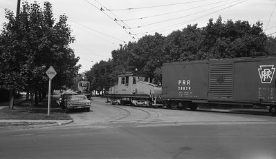 2018.15.N99H.8834--ed wilkommen 116 neg--Yakima Valley--electric locomotive 298 switching freight car in street--Yakima WA--no date