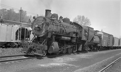 2018.15.N81.6229--ed wilkommen 116 neg--UP--steam locomotive 2-8-0 221 on freight train--location unknown--no date