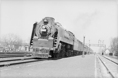 2018.15.N94.7153--ed wilkommen 6x9 neg--WAB--steam locomotive 4-6-4 P-1 702 on passenger train--Englewood IL--no date