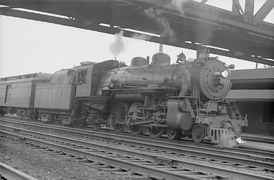 2018.15.N94.7147--ed wilkommen 6x9 neg--WAB--steam locomotive 4-6-2 J-1 on passenger train--Englewood IL--no date