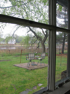 Looking outside from kitchen window to Buckeye Brook at high tide. This brick patio has been removed and replaced with fieldstone patio that Cal put along with paths to gardens and to the water.