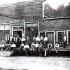 "W. M. Ritter Lumber Co. Store at Mortimer--Carl Osborn ""Carlie"" Seated 3rd man from right (2nd seated)."
