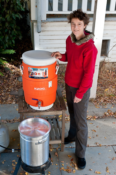 Ellen shows off her home-brewing set-up, a propane tank,  an Igloo cooler and a  (not sure the tech name for the large pot).