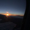 Sunrise over the wing of the airplane