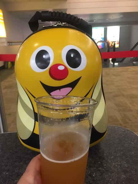 Buzzie Jr enjoys a beer at Stewart Airport waiting to depart