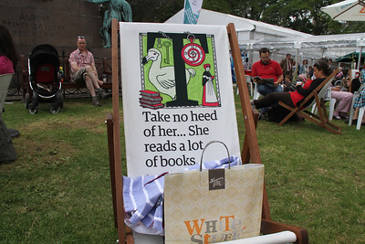 I'm not sure I can follow the sentiment on the chair just vacated by herself.  She does read many books, though.   The boy in the bad shirt doesn't look happy.....