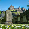 Looking up to the Castle from St Cuthbert's kirkyard