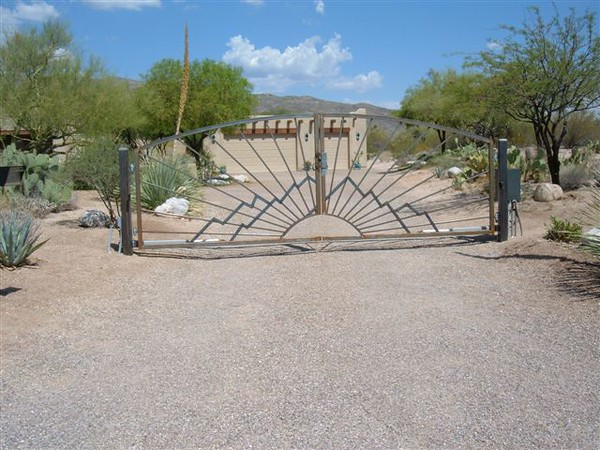 Residential Dual Swing gate with operator raw steel to be naturally rusted