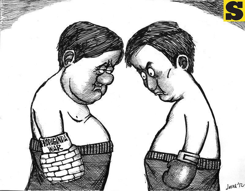 Propaganda War. Sun.Star Cebu editorial cartoon for October 19, 2012. (Josua Cabrera)