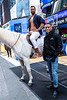 Old Spice Guy, Isaiah Mustafa makes his epic shirtless return, while riding on a white horse at Military Island in Times Square passing the torch to his TV son, actor Keith Powers, launching the Old Spice Ultra Smooth lineup, New York, USA