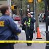 Feb. 10, 2015<br /> Charleston Police officers patrol St. Philip Street during a bomb threat investigation. (Photo/Ashley Heffernan) Charleston Regional Business Journal, all rights reserved Feb. 10, 2015.
