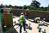 Work crews assemble the decking on the outside patio at Mount Pleasant Town Hall's new building. (Photo/Andy Owens)