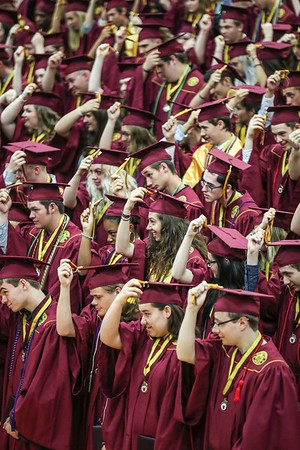 Evan De Stefano | Herald-Times Graduates move their tassels from right to left during the Class of 2018 Commencement at Bloomington High School North in Bloomington, Ind. Saturday, June 2, 2018.