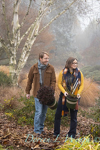 Justin & Megan with red and gold plant pick_1120