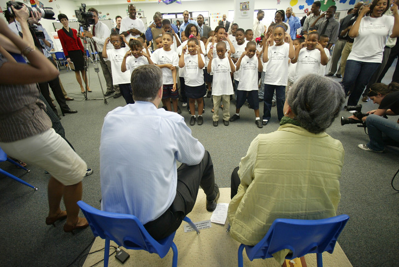 US Sec of Education Arne Duncan, left, and Marian Wright Edelman, right, listen to CDF students sing to them during a site visit in New Orleans, La.