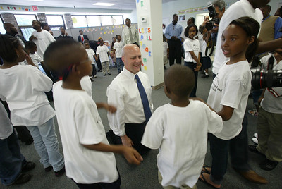 Mayor Mitch Landrieu, New Orleans, La, chats with children from the Children's Defense Fund Freedom School during a site visit.