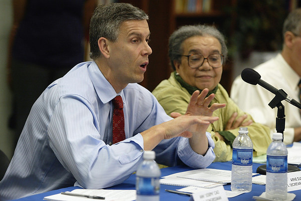 Arne Duncan, US Sec. of Education makes a case about the importance finding young African American men to teach in urban schools across the country and Marian Wright Edelman looks on, Friday, May 7, 2010.
