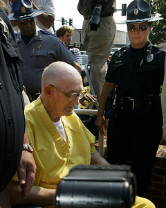 One time Klu Klux Klan leader Edgar Ray Killen is wheeled into the Neshoba County Courthouse for his sentencing hearing after being convicted of  three counts of manslaughter on Tuesday, June 21, 2005 for the deaths of the three civil rights workers in 1964, in Philadelphia, Miss., June 23, 2005.(AP Photo/Charles Smith)