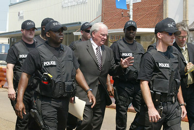 Defense attorney James McIntyre, center,  is escorted by the Philadelphia, Miss. police department security detail out of the courthouse after his client, Edgar Ray Killen was sentenced to 60 years for the murders of the civil rights workers in 1964, Thursday, June 23, 2005 in Philadelphia, Miss. (AP Photo/Charles Smith)