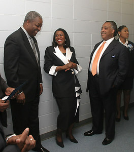 Rev. Al Sharpeton shares a laugh with Glenda Glover, Ph.D, Dean of the JSU School of Business, center, and Mayor Harvey Johnson, left, Wednesday, April 7, 2004 in Jackon, Miss. Rev. Sharpeton was serving as keynote speaker at the School of Business' annual awards dinner.(AP Photo/Charles Smith)
