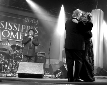 Governor Haley Barbour dances with his wife, Marsha as legendary entertainer Percy Sledge sings to the crowd, Tuesday, January 13, 2004 in Jackson, Miss. (AP Photo/Charles Smith)