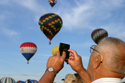 Attendance at the Balloon Fiesta ranges from families with babies all snug in their strollers, to gadget-hip seniors enjoying their retirement in style. A family friendly atmosphere & a pioneer's spirit flows around the inner launch zone during morning ascension.