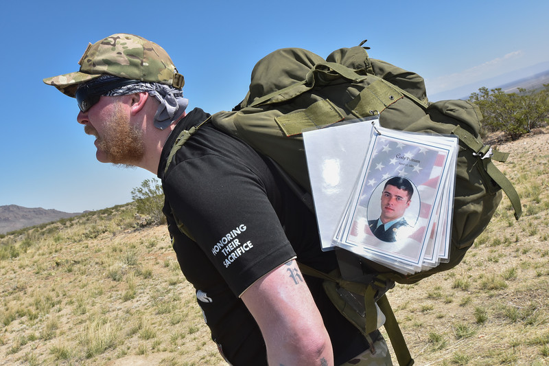 """Chops"" has a ring on either side of his ruck with 52 of his comrades represented that he has lost. He turns a page once an hour to honor each comrade."