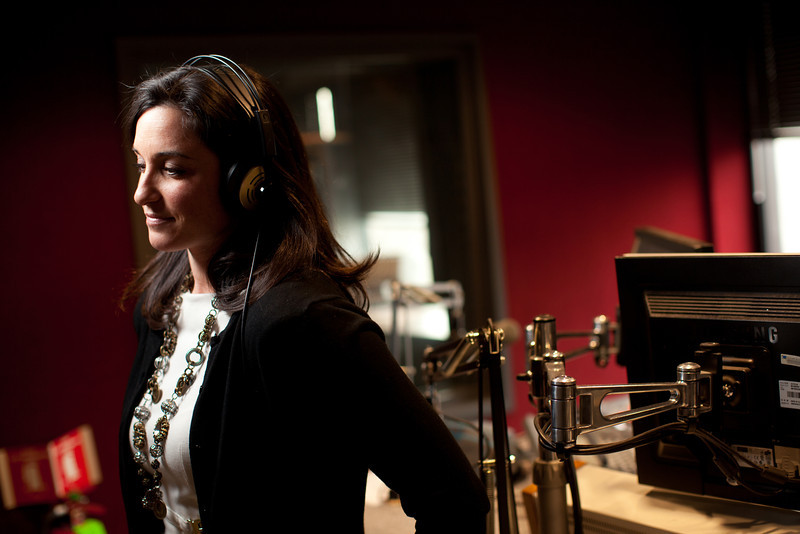 "2/1/12 Medford, MA -- For the purposes of this photo, Kendra Petrone listens to an Adele song at Kiss 108 studios in Medford, February 1, 2012.   Petrone is a Producer for the Matty in the Morning Show and says the Adele song ""Someone Like You"" would make her emotional whenever it would come at the station.  ""It's the way she describes her heartbreak.  Every girl I know, including myself, has had that feeling.  She nailed it.  It hits home,"" Petrone said.   Erik Jacobs for the Boston Globe"