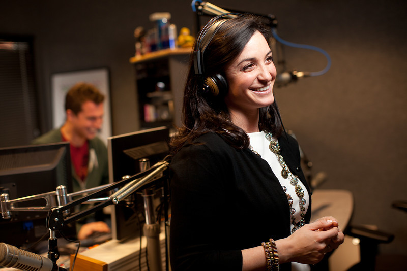 """2/1/12 Medford, MA -- For the purposes of this photo, Production Director Rich DiMare (background) queues up an Adele song for Kendra Petrone at Kiss 108 studios in Medford, February 1, 2012.   Petrone is a Producer for the Matty in the Morning Show and says the Adele song """"Someone Like You"""" would make her emotional whenever it would come at the station.  """"It's the way she describes her heartbreak.  Every girl I know, including myself, has had that feeling.  She nailed it.  It hits home,"""" Petrone said.   Erik Jacobs for the Boston Globe"""