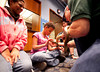 11/7/09 Boston, MA -- At left, Shanakawa Pereira watches as Hope Daniels, 10, works up enough nerves to pet Tannis, a green anaconda during a family overnight at the aquarium November 11, 2009.  Despite being a little hesitant at first, Pereira said that petting the snake was not scary like she originally thought.  Erik Jacobs for the Boston Globe