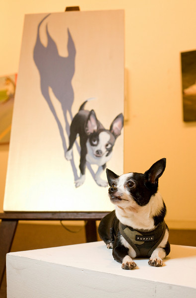 "12/7/08 Somerville, MA -- ADVANCE for Living. Portrait of Denise Lindquist's pet chihuahua Ari with the painting Lindquist commissioned from painter Jane O'Hara called ""Ari's Night"" at the Best In Show: Artists and their Dogs exhibit at the Brickbottom Gallery in Somerville, December 7, 2008.  Erik Jacobs for the Boston Globe"