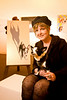 "12/7/08 Somerville, MA -- ADVANCE for Living. Portrait of Denise Lindquist of Raynham and her chihuahua Ari with the painting Lindquist commissioned from painter Jane O'Hara called ""Ari's Night"" at the Best In Show: Artists and their Dogs exhibit at the Brickbottom Gallery in Somerville, December 7, 2008.  Erik Jacobs for the Boston Globe"