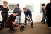 "12/7/08 Somerville, MA -- ADVANCE for Living. Denise Lindquist (left) of Raynham and her chihuahua Ari meet a Boston Terrier named Pogo who came with owner David Tonnesen of Somerville to the Best In Show: Artists and their Dogs exhibit at the Brickbottom Gallery in Somerville, December 7, 2008.  At far left is painter Jane O'Hara who did a painting of Ari called ""Ari's Night"" at Erik Jacobs for the Boston Globe"