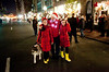 "12/10/09 Boston, MA -- ADVANCE for Boston.com.  Twin reindeer, from left, Emilie and Sarah Gurnon, 12, walk with their dad Jack Gurnon and their dog Emma to the Christmas tree lighting during the Beacon Hill Holiday Stroll December 10, 2009.  ""This event is always fun,""<br /> Jack said, ""especially on a night like this."" Erik Jacobs for the Boston Globe"