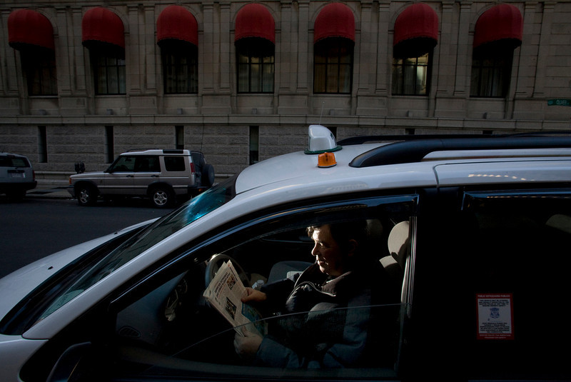 12/6/07 Boston, MA -- Gregory Brin reads his Russian newspaper while waiting at a taxi stand in Boston Thursday December 6, 2007.  Erik Jacobs for the Boston Globe