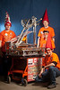 "4/7/11 Boston, MA -- Advance for Boston.com. Team – Cyber Gnomes<br /> High School – Stayner Colligate Institute<br /> From – Ontario, Canada<br /> Team Motto – ""You'll never see us coming!""<br /> Robot Name – The Gnominator""<br /> Robot's Strength – Powerhouse -  8-wheel-drive and 6 motors on the drive train. ""We push people around.""<br /> Pictured – From left, builder Matt White, 16, (and background to foreground) builder/programmer Justin Webster, 18, captain/driver Andrew Bronée, 16, mentor/coach Aaron Bronée, 25.<br /> Anything Else? – ""If we can get our software sorted out, we stand a good chance""<br /> The 20th Boston Regional First Robotics Competition at the Agganis Arena April 7, 2011.  Erik Jacobs for the Boston Globe"
