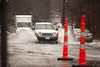 3/15/10 Winchester, MA -- Cars contend with flooding along Washington Street in WInchester, Mass March 15, 2010.