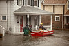 3/15/10 Winchester, MA -- Winchester resident Paul Welliver and a member of the Winchester Fire Department work to evacuate residents stranded by flooding along Forest Street in WInchester, Mass March 15, 2010.