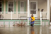 "3/15/10 Winchester, MA -- Emily Bushnell evacuates her dog Wally from her home during flooding along Forest Street in WInchester, Mass March 15, 2010.  ""I have lived here for 25 years and we have had five 100-year storms,"" Bushnell said."