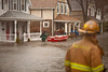3/15/10 Winchester, MA -- Winchester resident Paul Welliver and members of the Winchester Fire Department work to evacuate residents stranded by flooding along Forest Street in WInchester, Mass March 15, 2010.