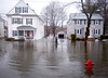 3/15/10 Winchester, MA -- Paul Welliver surveys the flooding along Forest Street where Welliver lives in Winchester, Mass March 15, 2010.