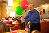 4/20/12 Hanover, MA -- After using the balloons for a portrait, John Maguire gives the balloons to some young customers in a Friendly's in Hanover, including Charlie Niehoff, 6, of Hingham, Mass. April 20, 2012. Erik Jacobs for the Boston Globe