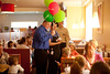 4/20/12 Hanover, MA -- After using the balloons for a portrait, John Maguire gives the balloons to some young customers in a Friendly's in Hanover, Mass. April 20, 2012. Erik Jacobs for the Boston Globe