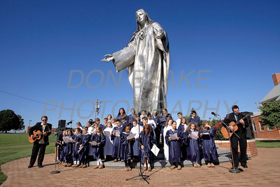 Students from St. Anthony of Padua School sing as Catholic school students from around the Diocese gather for the Rosary Rally at the Our Lady Queen of Peace statue on the grounds of Holy Spirit Church in New Castle, Friday, October 7, 2011. photo/Don Blake Photography