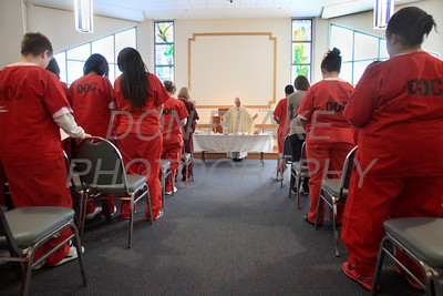 Bishop Malooly celebrates mass at the Baylor Women's Correctional Institution, New Castle, Del., Monday December 19, 2011. photo/Don Blake Photography.com