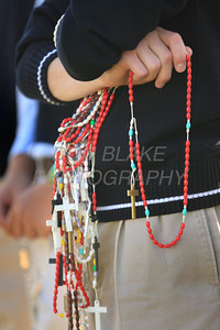 A student holds extra rosaries as Catholic school students from around the Diocese gather for the Rosary Rally at the Our Lady Queen of Peace statue on the grounds of Holy Spirit Church in New Castle, Del., Friday, October 7, 2011. photo/Don Blake Photography