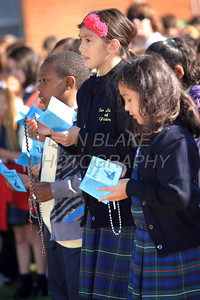 Gina Fierro (left)  and Sophia Alafriz 3rd grade students from Our Lady of Fatima School pray the rosary as Catholic school students from around the Diocese gather for the Rosary Rally at the Our Lady Queen of Peace statue on the grounds of Holy Spirit Church in New Castle, Friday, October 7, 2011. photo/Don Blake Photography