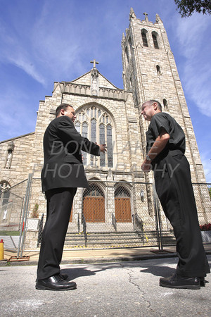 Bishop Malooly (left) and  Fr. Steven Hurley, Pastor of St. Thomas the Apostle Church in Wilmington, Del, survey the damage after the magnitude 5.8 earthquake that shook the east coast, Tuesday, August 23, 2011. The Dialog/Don Blake